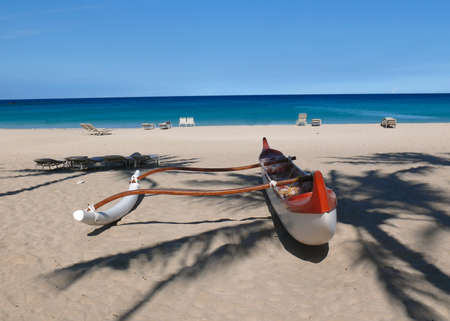 Red and white outrigger at peopleless Kauna'oa Beach, Hawaii Stock Photo - 7742881