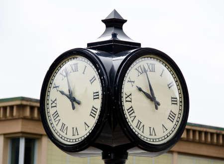 clock: Street clock  at Harrison lake resort, reminding owl face