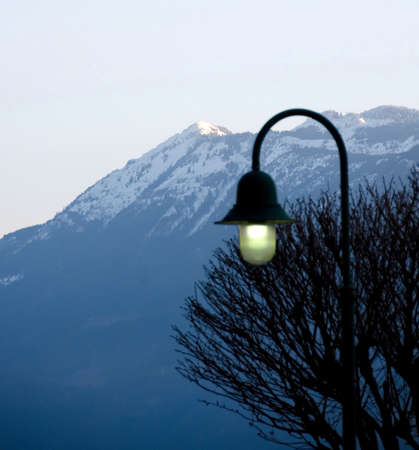ranges: Streetlamp is still while at sunrise sets over  Harrison Lake