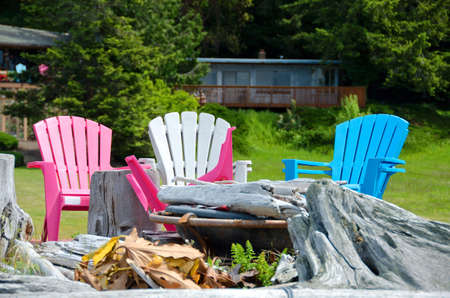 log deck: Beach  chairs in front of fireplace with dry logs