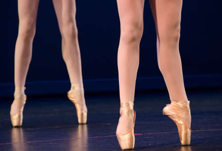 Legs of duo of ballerinas on pointe photo