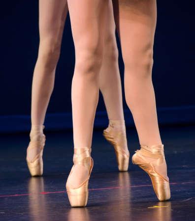 Legs of duo of ballerinas on pointe photo
