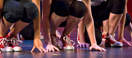 Feet and arms of hip-hop performers photo
