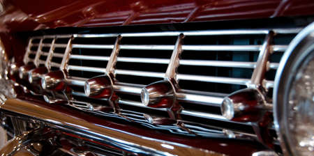 Chrome front grill of a classic bordeaux car photo