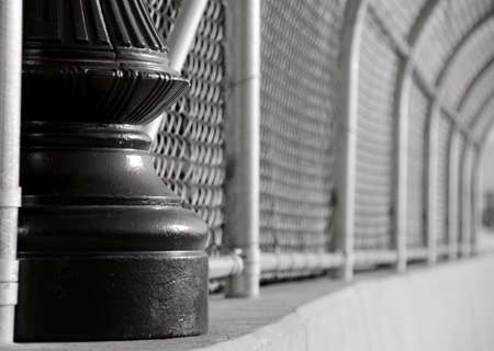 Cast iron pole and alloy mesh  on a bridge in Tacoma Stock Photo - 17973877