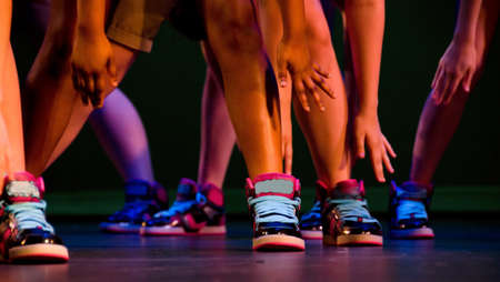 hop: Feet, ankles and arms of hip-hop performers in colorful sneakers