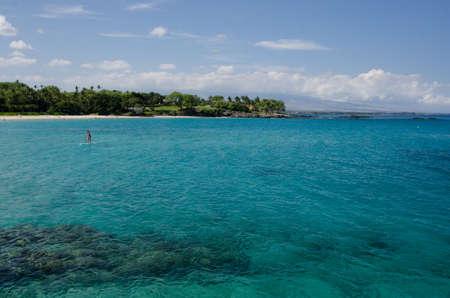 careless: Careless alone surfer  at Kaunaoa beach