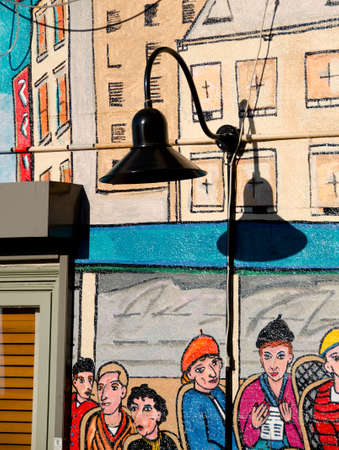 pike place: Artful graffiti blended with street lamp near Pike Place Editorial