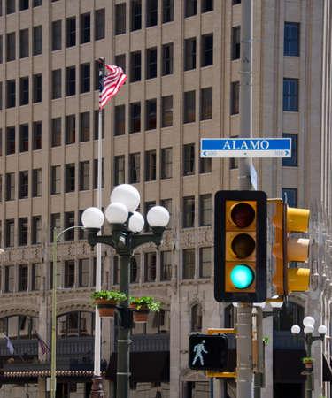 street signs: Street signs, lamps, and lights near Alamo mission, San Antonio Stock Photo