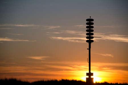 shores: Tsunami warning tower at a beach near Ocean shores, WA, in sunset highlights