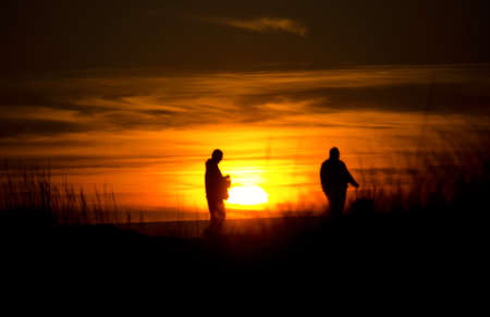 shores: Hikers walk on a beach near Ocean Shores during gorgeous sunset