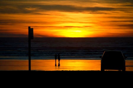 shores: Beachgoers parked an SUV on a beach near Ocean Shores and went watching sunset