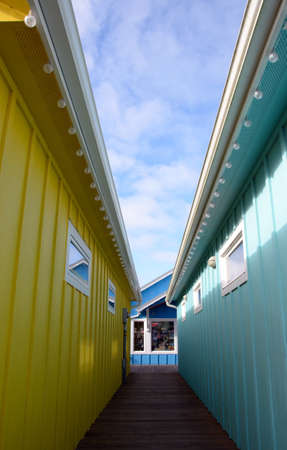 toyshop: Path to a toyshop between colorful walls of cabins in Ocean Shores