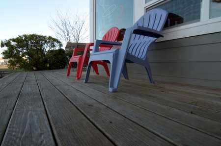 shores: Garden chairs on a wooden deck in front of a coffee shop in Ocean Shores