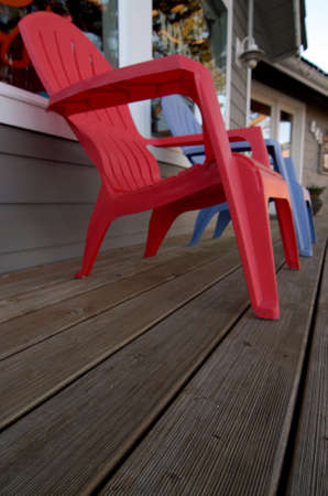 shores: Wooden deck with garden chair in front of a cafe in Ocean Shores