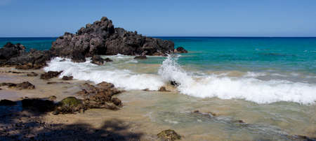 breakaway: Surf around rocks of Puako beach, Waialea, Big Island Stock Photo