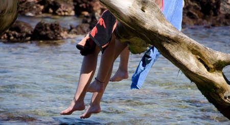 careless: Careless legs of beachgoers at Beach 69, Waialea, Big Island Stock Photo