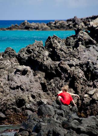 breakaway: Kids hiding in lava rocks at Beach 69, Waialea, Big Island