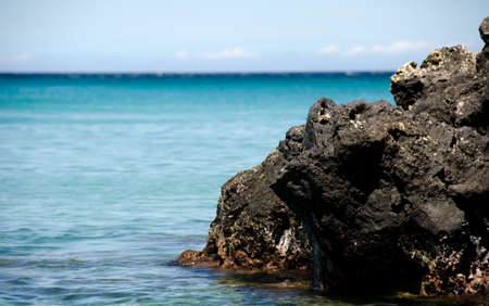 submerging: Submerging in quiet waters of Beach 69, Waialea, Big Island Stock Photo