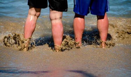 overly: Overly enthusiastic sunbathers at Mauna Kea Beach Big Island Hawaii Stock Photo