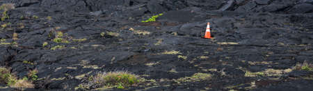 lava field: Construction cone on lava field near Chain of Craters road Volcano state park Hawaii