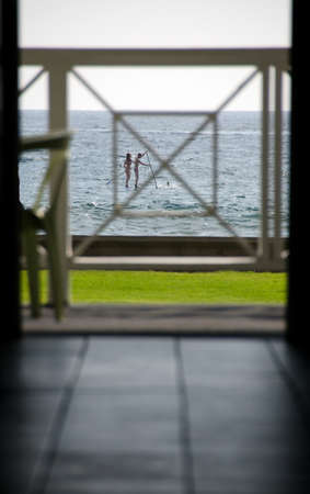 kona: Watching board paddlers in Kailua Bay through the door of a cafe Big Island