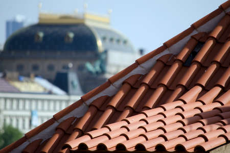 apartment tower old town: Red tile Roof with National Theater in the background, Prague