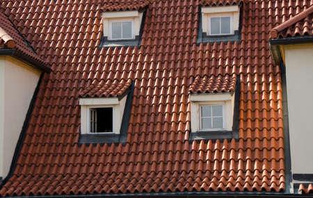apartment tower old town: Square windows of mansards in Mala Strana, Prague Stock Photo