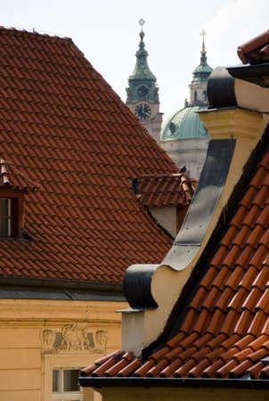 spires: Spires between red tiles in Mala Strana, Prague Stock Photo