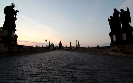 statuary: Cobblestones of Charles bridge near Statuary of St. John of Matha, St. Felix of Valois and St. Ivan, Prague