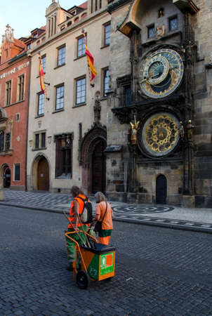 astronomic: Street janitors on shift near Astronomic clock tower, Prague