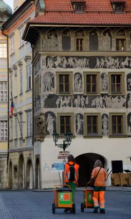 stare mesto: Street janitors on shift near Old Town Hall. Stare Mesto; Prague Stock Photo