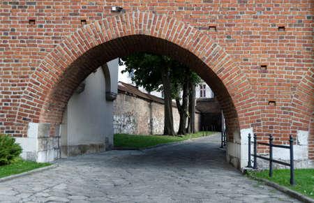 corpus: Cobblestone alley under the arch behind Corpus Christi Basilica, Kazimierz, Poland
