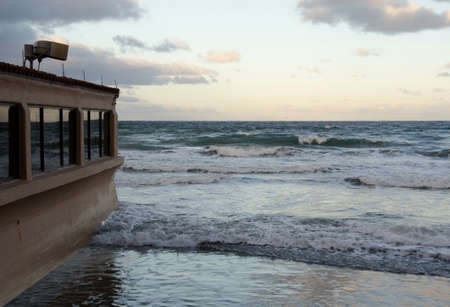 storm tide: High tide at a beach resort in Southern California.