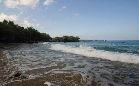 breakaway: Early waves at beach 69, Big Island, Hawaii