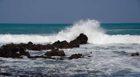 breakaway: Morning surf breaks on rocks of beach 69 -4, Big Island, Hawaii