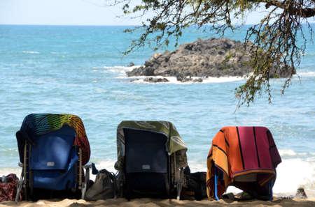 breakaway: Beach chairs under towels at Wailalea beach, Big Island, Hawaii