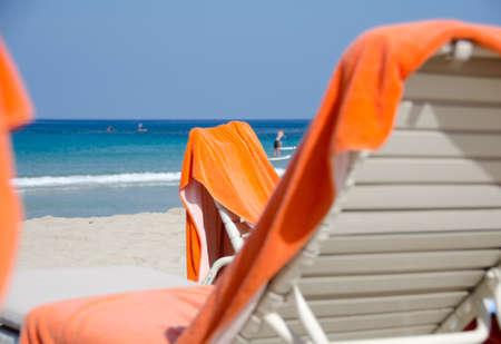 boogie: Bright orange beach towels and chairs at Kaunaoa beach; Big Island; Hawaii