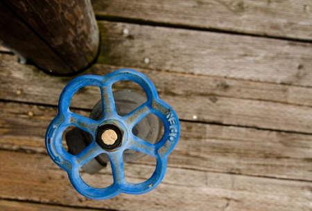 spigot: Blue rusty spigot on a deck in marina, Kirkland, Washington Stock Photo