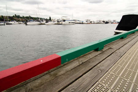 seafronts: Red and green rail on a deck in a marina, Kirkland, Washington Stock Photo