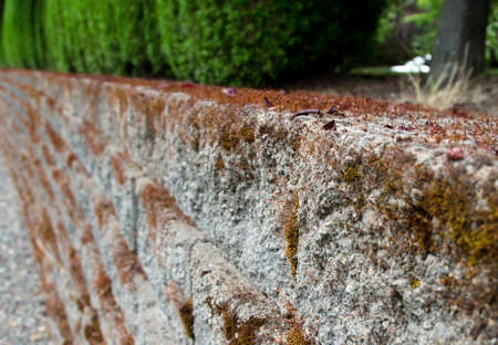 retaining: Stone retaining wall covered by moss, Redmond suburbs