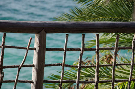 drywood: Wooden mesh and fence  near palm trees at Cocobay beach, Antigua