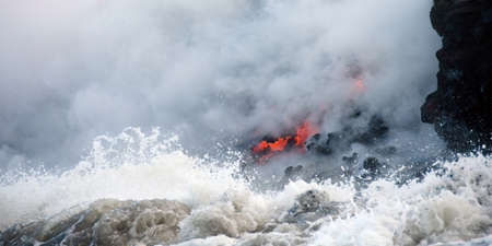 eruption: Watchig steam and glow of Kilauea volcano lava flow from a boat , Hawaii