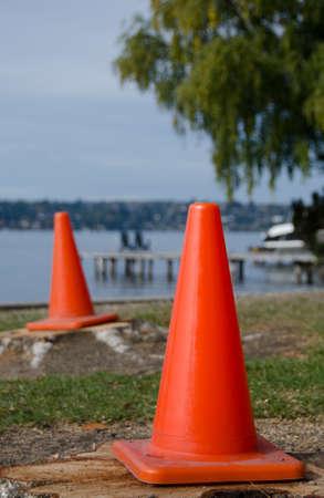 Construction cones near Washington lake surf line in Medina beach park, Bellevue, Washington