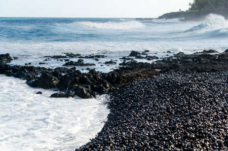 Rough surf at edge of black sands of Pohoiki beach, Isaac Hale Beach Park, Big Island, hawaii