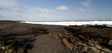 Black sands and rocks at Pohoiki  beach, Isaac Hale Park Stock Photo