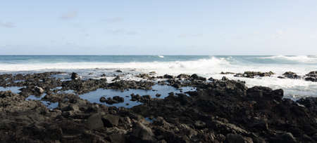 Rough surf  at edge of black sands of Pohoiki  beach, Isaac Hale Beach Park, Big Island, hawaii