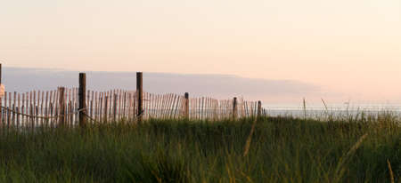 Dune  protection fence at Westport beach highlighted by sunset, Grays Harbor