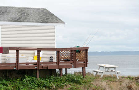 White fisher cabin with rods on the brown deck near Westport marina, Grays Harbor Stok Fotoğraf