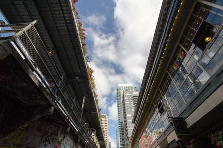 Walking up the Pike  Street to the 1st Avenue between glass walls